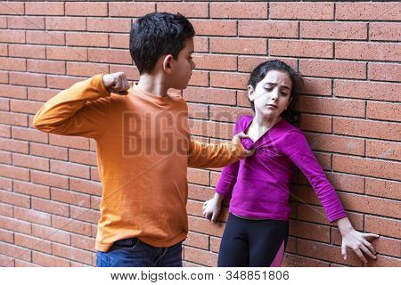 Little Kid Hitting Another On The School. Bullying Concept