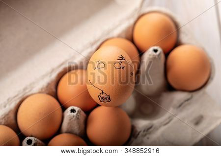 One Egg Stands Out From Crowd Of Other Eggs. Concept Of Rejection, Hostility, Exclusion, Exile