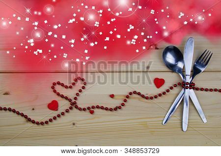 Valentine Concept. Fork, Knife And Tablespoon Tied With Red Pearls. Pink Smoke With Magic Light.invi