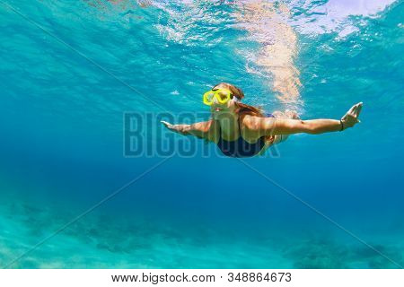 Happy Family - Active Young Woman In Snorkeling Mask Dive, Swim Underwater To See Tropical Fishes In