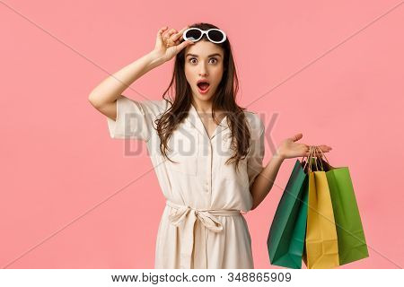 Lets Go Shopping. Amused And Excited Female Shoppaholic Having Fun Browsing Through City Malls, Hold