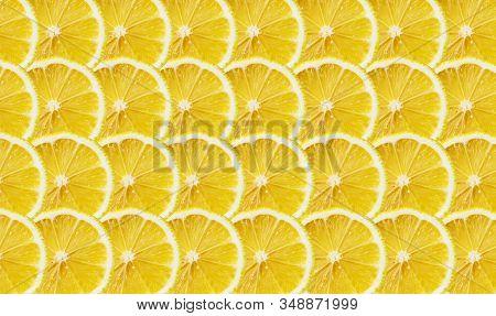 Juicy Yellow Slice Of Lemon Fruit Pattern Background, Flat Lay. Lemon Decoration.