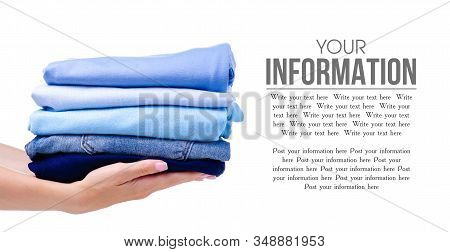 Stack Blue Folded Clothing In Hand On White Background Isolation, Space For Text