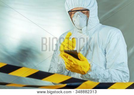 Epidemiologist Using Smartphone In Hospital Virus Infection Quarantine, Selective Focus