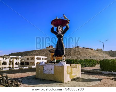 Egypt, Sharm El Sheikh - January 17, 2020: Statue Of An Arab Woman Holding A Large Dish With Birds O