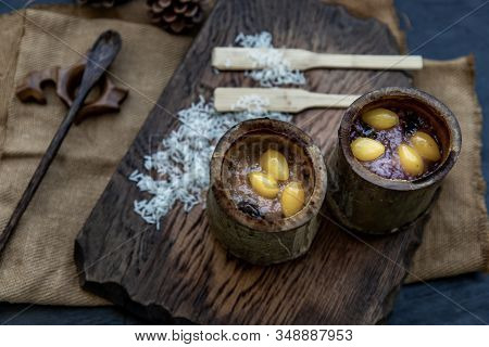 Sticky Rice Cooked With Coconut Milk (khao Lam) Or Glutinous Rice Roasted In Bamboo Joints On Wooden