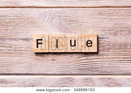 Flue Word Written On Wood Block. Flue Text On Wooden Table For Your Desing, Coronavirus Concept Top