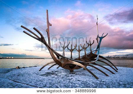 Reykjavik, Iceland. - 17 January 2020: The Sun Voyager, a modern sculpture by Jon Gunnar Arnason, of a viking ship. Sunset in Reykjavik, Iceland.