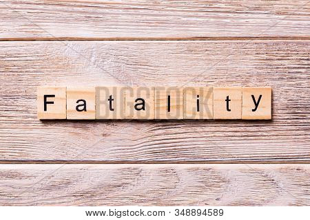 Fatality Word Written On Wood Block. Fatality Text On Wooden Table For Your Desing, Coronavirus Conc