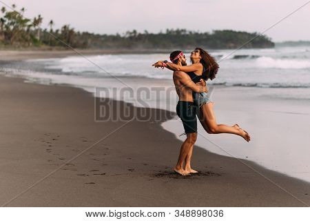 Couple On Their Honeymoon. Couple Travels The World. Happy Couple On Vacation. Man And Woman Traveli