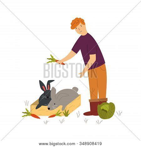 Scene With A Farmer Feeding Cute Rabbits