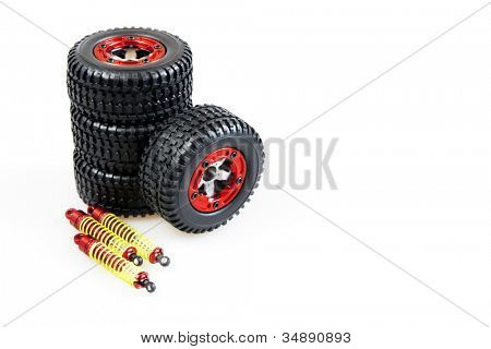 shock-absorbers and wheels of rc car on a white background