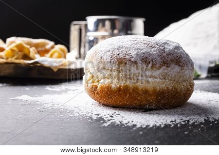 Donut Covered With Powdered Sugar On The Stony Worktop.