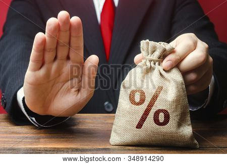 A Man Refuses To Give A Loan Credit Money Bag. Financial Difficulties. Refuses Cooperate. Sanctions,
