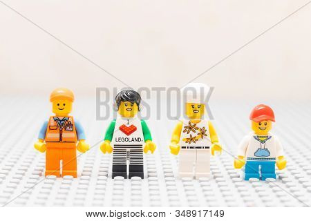 Kouvola, Finland - 18 December 2019: Friendship Of Lego Minifigures Staying On Gray Baseplate
