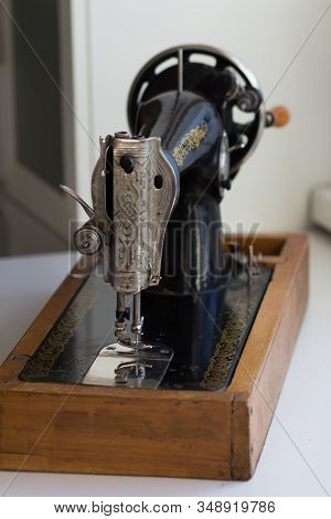 Face Plate Of The Old Manual Sewing Machine Consists Of Presser Bar Lifter, Needle Thread Tension As