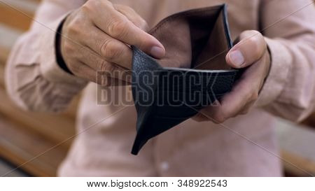 Elderly Man Holding Empty Purse, Lack Of Money, Pension Poverty, Bankruptcy