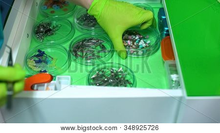 Stomatologist Choosing Bleaching Tip, Professional Tools In Modern Clinic