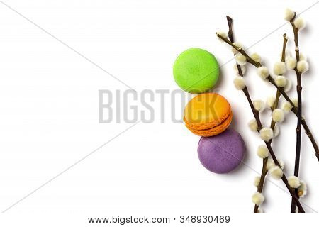 Colorful Macaroons With Willow Isolated On White. Green, Orange And Purple French Cookies With Fresh
