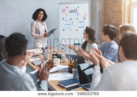 International Business Team Applausing To Black Lady Speaker, Afro Woman Making Business Presentatio