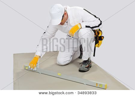 Worker Checks Levels Of Cement-base