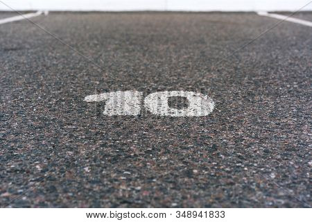 Number Ten Painted White Paint On Road For Cars Parking