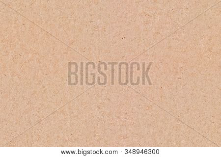 Close Up Of Light Brown, Smooth Cardboard With Large Visible Paper Fibers In The Texture.  Blank And