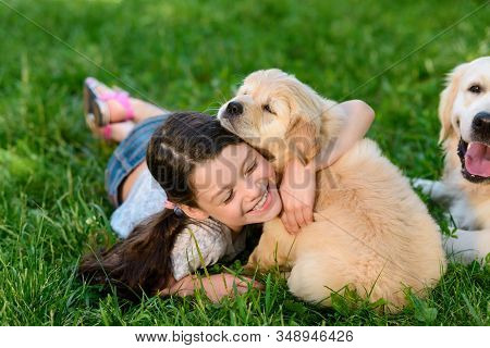 Girl Playing With Her Dogs In The Backyard