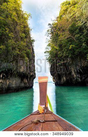 A Boat Sailing In The Blue Water Of Hong Island (lagoon, Hong Island, Krabi), Krabi, Thailand