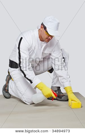 Worker Sponge Clean Cement Substrate