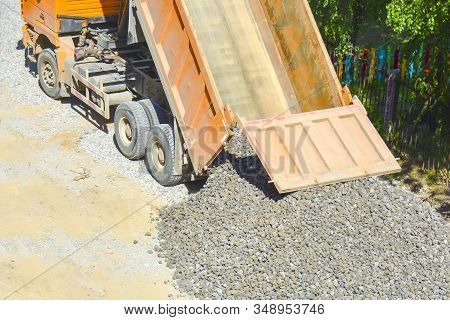 The Process Of Unloading A Dump Truck, Dump Truck Unloads Rubble On The Ground, Top View. The Concep