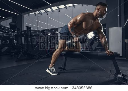 New Day For Power. Young Muscular Caucasian Athlete Practicing In Gym With The Weights. Man Doing St