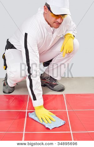 Worker With Yellow Gloves Blue Towel Clean Red Tiles Grout