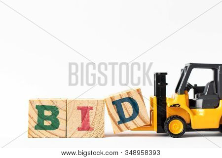 Toy Forklift Hold Wood Letter Block D To Complete Word Bid On White Background