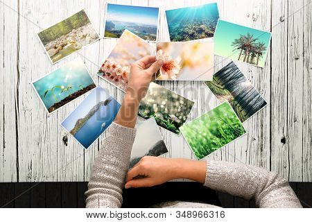 woman looking at photos, remember nostalgia for a day of rest. Spring Photo