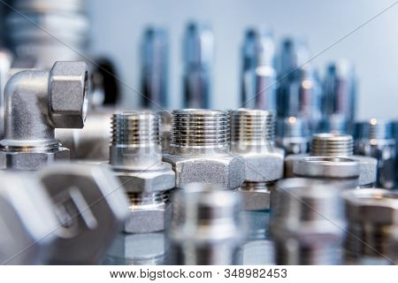Hosepipe Fittings On The Table. Plumbing Pipeline Spare Parts.