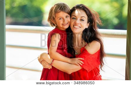 happy mother with daughter in the park