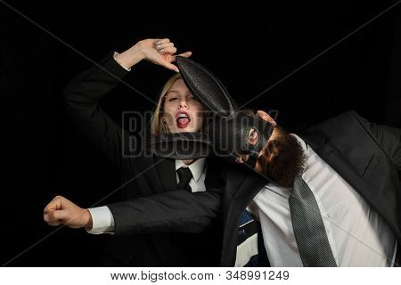 Couple Woman In Rabbit Costumes And Man In Suit. Lovers Are Fooling Around. Handsome Man With Beard