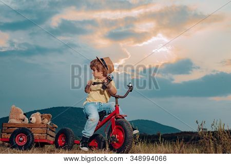 Emotions On The Face. Happy Smiling Child On Nature Background. Adorable Kid Having Fun. Happy Child