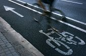 Speedy cyclist commuting on an urban cycleway. poster