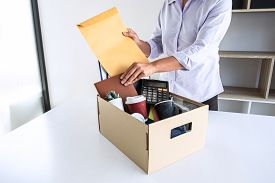 Images Of Stress Of Woman Employee Has A Brown Cardboard Box And Intend Sending Resignation Letter T