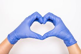 Heart Made Of Latex, Nitrile Medical Gloves For Doctor And Nurse Protection On White Background.