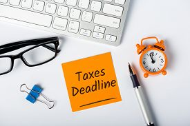 Taxes Deadline Or Tax Time - Notification Of The Need To File Tax Returns, Tax Form At Accauntant Wo