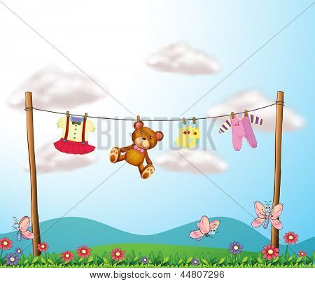 Illustration of a child's clothes hanging with a teddy bear
