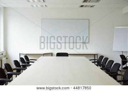 Clean bright white conference room with a whiteboard