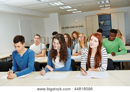 Many people doing further training in a school classroom