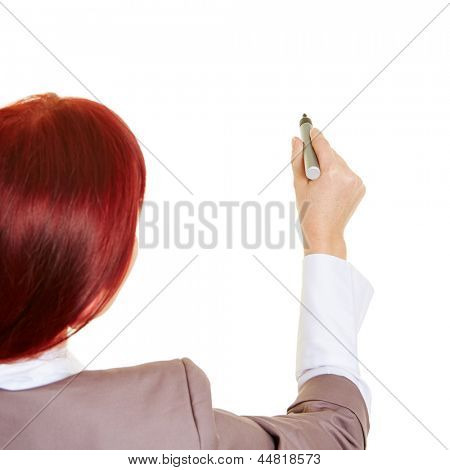 Business woman with pen writing into the air