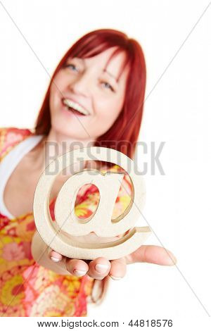 Happy woman holding at sign as internet symbol on her hand