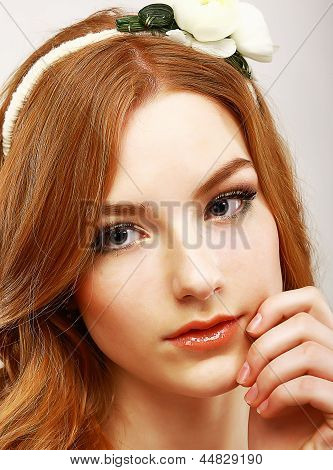 Goodness. Portrait Of Young Meek Woman With White Flower On Her Head
