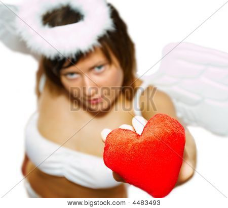 Young Woman At Angel's Costume With Red Heart